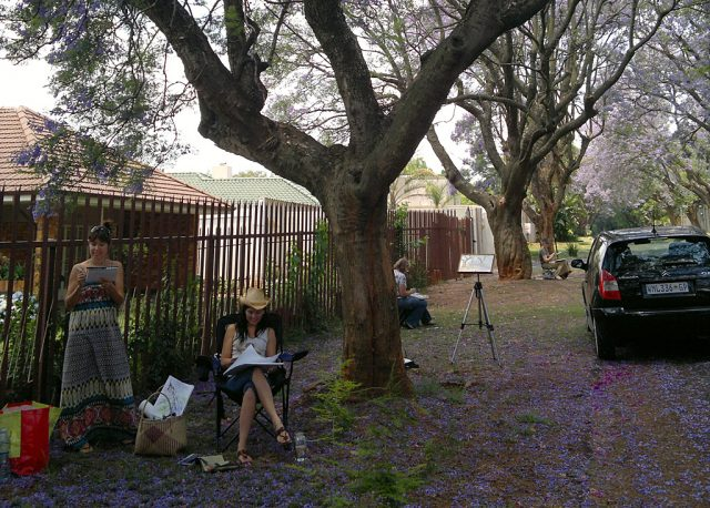 Jacaranda trees being painting by the artists.