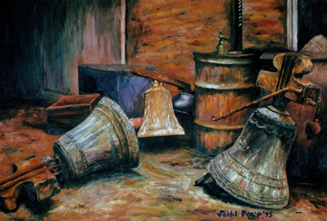 Still life of some drums and old church bells.